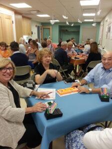 Having fun at the table in Westport's Come Play Bridge Club